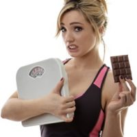 woman-holding-scale-and-chocolate[1]